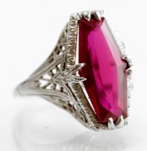 18K WHITE GOLD AND FANCY-CUT SYNTHETIC RUBY RING. RING SIZE 4 3/4; GROSS WEIGHT 3.9 GRAMS