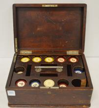 VINTAGE CLAY POKER CHIPS (APPROXIMATELY 200) WITH FITTED CASE. HEIGHT 5 1/2