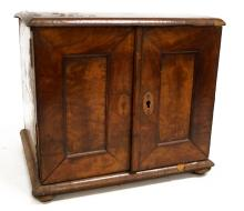 ANTIQUE BURL WALNUT 2-DOOR FOOTED CABINET WITH SHELVED INTERIOR. HEIGHT 9