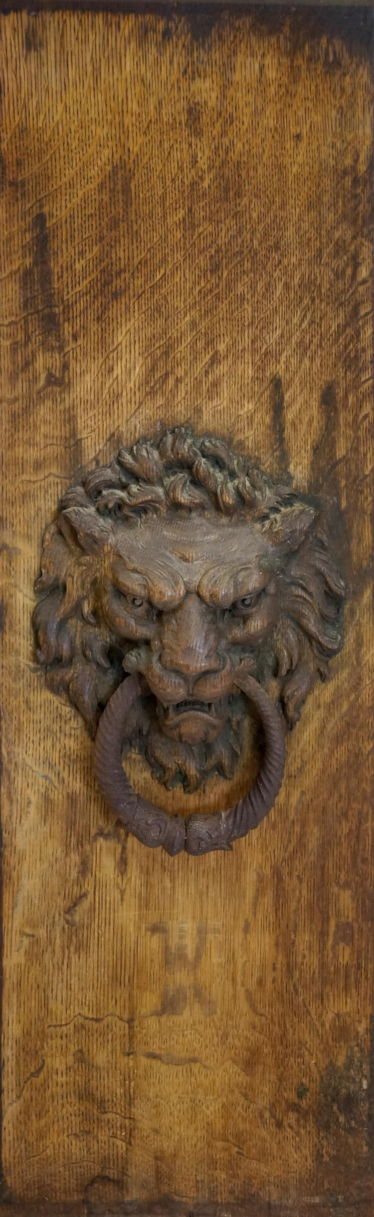 ANTIQUE CARVED OAK PANEL WITH LION HEAD AND WROUGHT IRON RING. PANEL/OVERALL 39 1/2 X 12 3/4