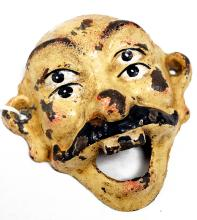 UNUSUAL CAST IRON WALL MOUNTED FOUR-EYED FACE BOTTLE OPENER BY WILTON PRODUCTS. HEIGHT 3 1/2