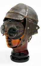 VINTAGE GLASS MANNEQUIN HEAD WITH VINTAGE LEATHER AVIATOR'S HELMET AND GLASSES. HEIGHT 12 1/2