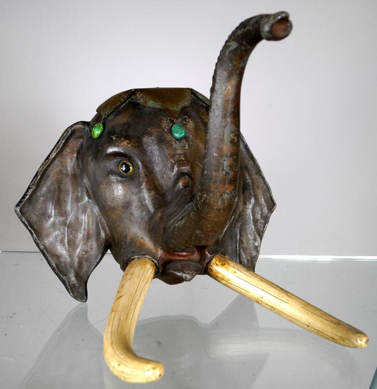 POLYCHROME METAL ELEPHANT WALL SCULPTURE WITH CARVED WOOD TUSK AND TURQUOISE DECORATION, EARLY 20TH CENTURY