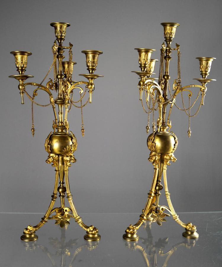 PAIR BRASS VICTORIAN STYLE 4-CANDLE CANDELABRAS WITH LION HEAD MOUNTS AND CLAW FEET. HEIGHT 21