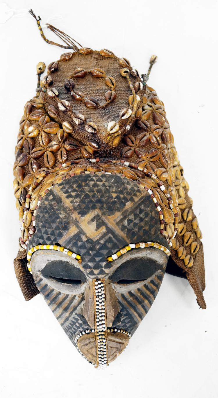 BAKUBA D.R.C. CARVED, PAINTED, AND BEAD MOUNTED MASK WITH COWRIE SHELL RAFFIA HOOD. HEIGHT 13