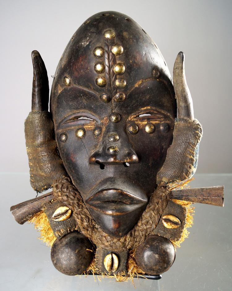 DAN, LIBERIA, MASK WITH HORN, SHELL, RAFFIA AND TACK DECORATIONS. HEIGHT 11