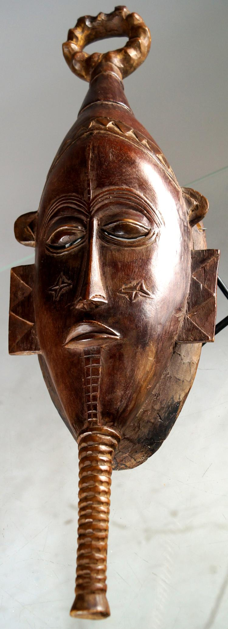 GURO, IVORY COAST, CARVED WOOD ANCESTOR MASK. HEIGHT 18 1/4