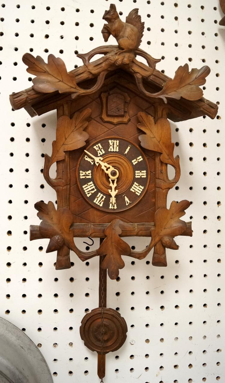 GERMAN BLACK FOREST CARVED CUCKOO CLOCK. HEIGHT 14