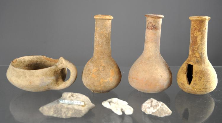 LOT (7) INCLUDING (4) HOLY LAND TERRA COTTA POTTERY BOTTLES AND LAMP, C.100BC-300AD; STONE FRAGMENTS FROM MASSADA AND NEGEV