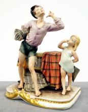 CAPO DI MONTE ITALIAN DECORATED PORCELAIN FIGURAL GROUP, NEWSPAPER BOY. HEIGHT 9 1/2