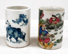 LOT (2) CHINESE DECORATED PORCELAIN BRUSH POTS INCLUDING FAMILLE ROSE AND BLUE/WHITE. HEIGHT 4 7/8