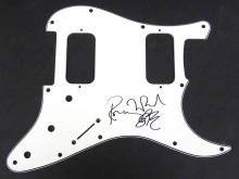 RONNIE WOOD (BRITISH ROCKER-ROLLING STONES 1947-), BLACK MARKER SIGNED GUITAR SCRATCH PLATE. 9 X 11