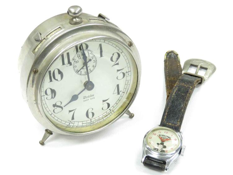 LOT (2) INCLUDING US TIME HOP-ALONG CASSIDY CHARACTER WRISTWATCH WITH ORIGINAL STRAP AND VINTAGE WESTCLOX BABY BEN ALARM CLOCK, HEIGHT 3 1/4