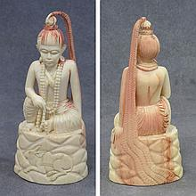 INDIAN CARVED IVORY FIGURE OF A SEATED DEITY