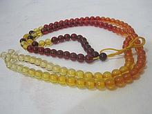 An Antique Chinese Qing Amber Prayer Beads