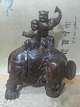 A Chinese Qing Sandalwood Children and Elephant Carving
