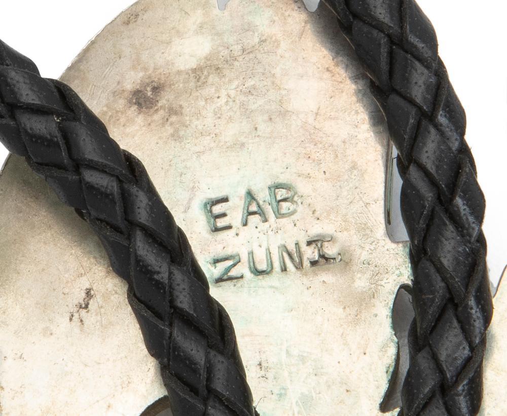 A Zuni bolo tie and brooch