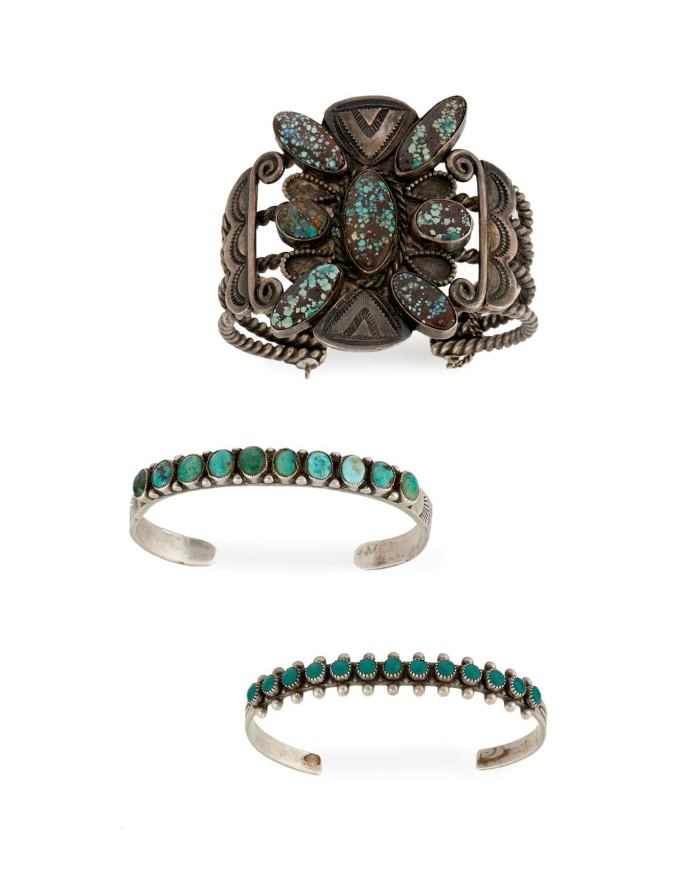 Three silver and turquoise cuff bracelets