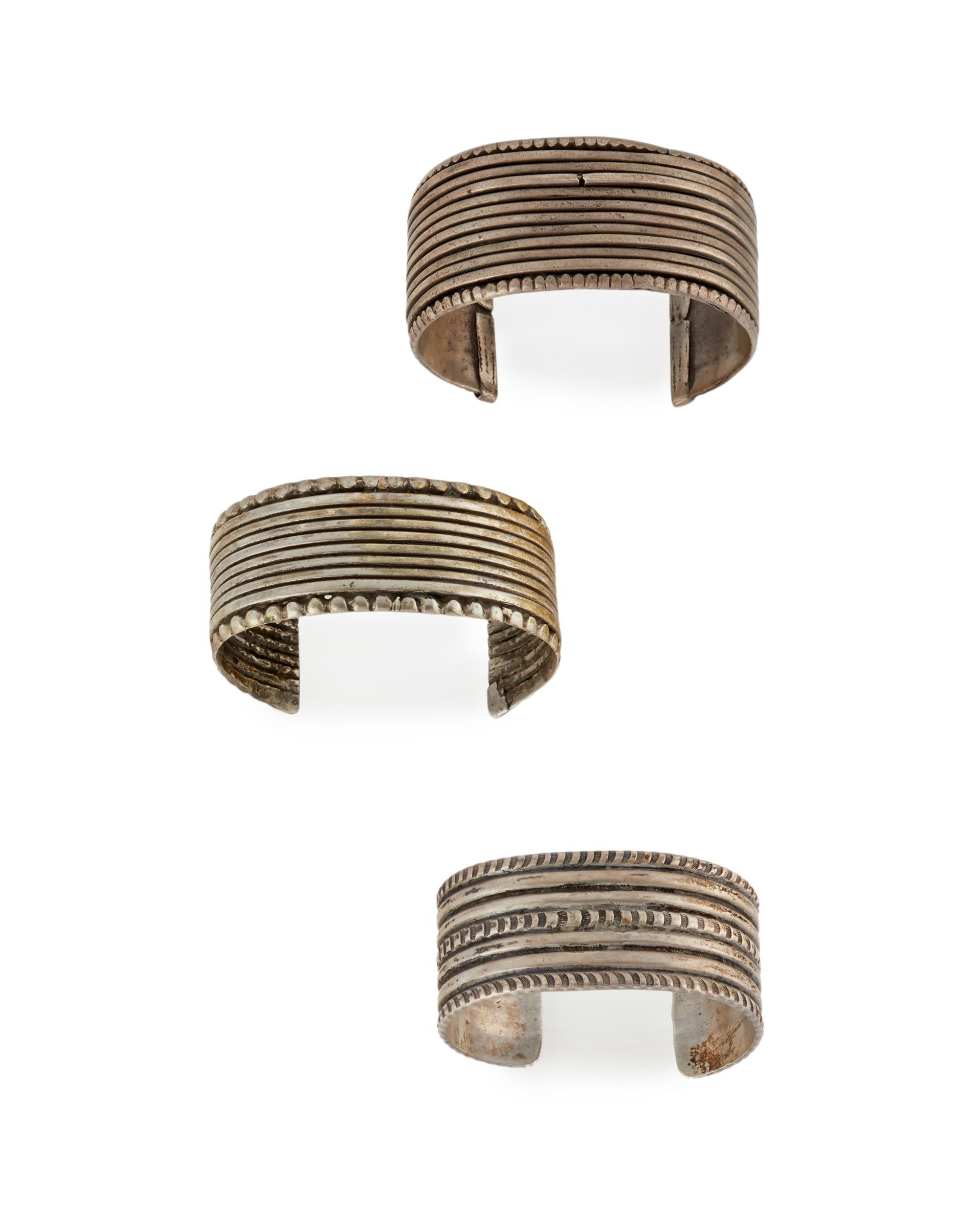 Three silver cuff bracelets