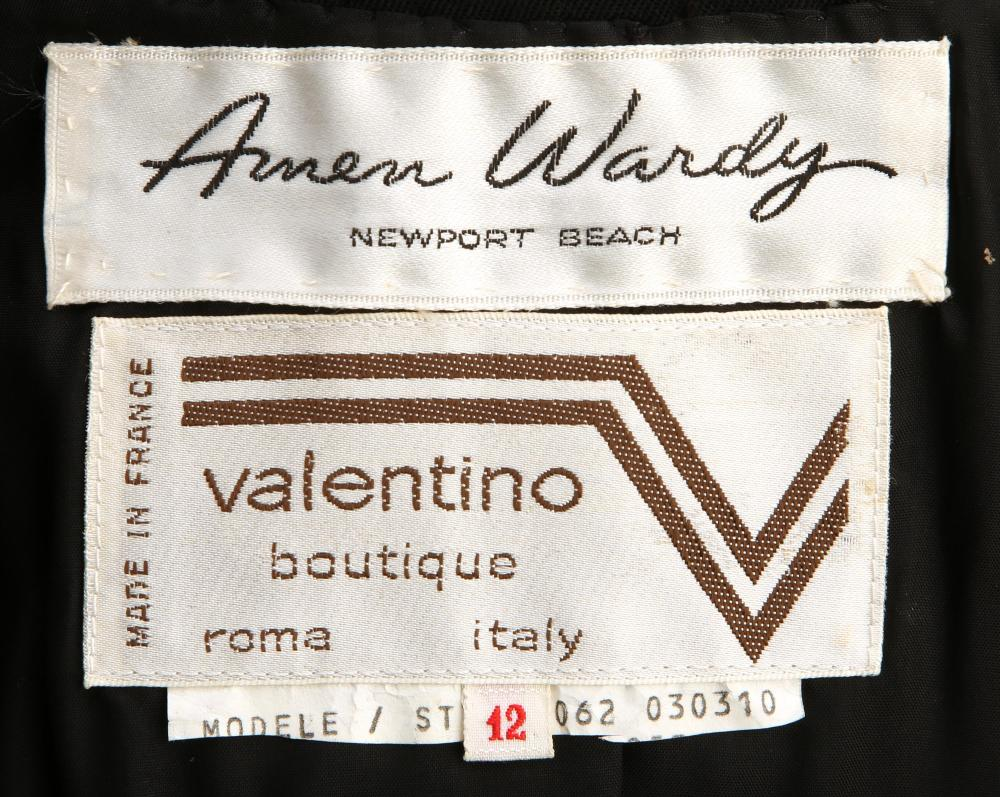 A Valentino suit and a Diorling trenchcoat