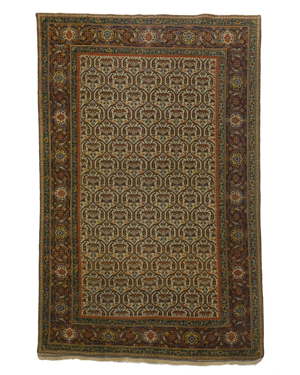 A hand-knotted Fereghan rug