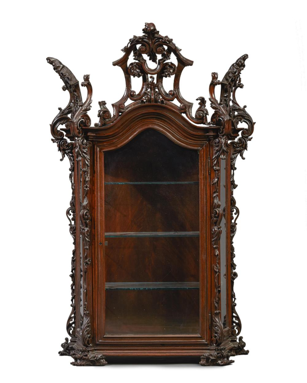 A Continental carved curio cabinet