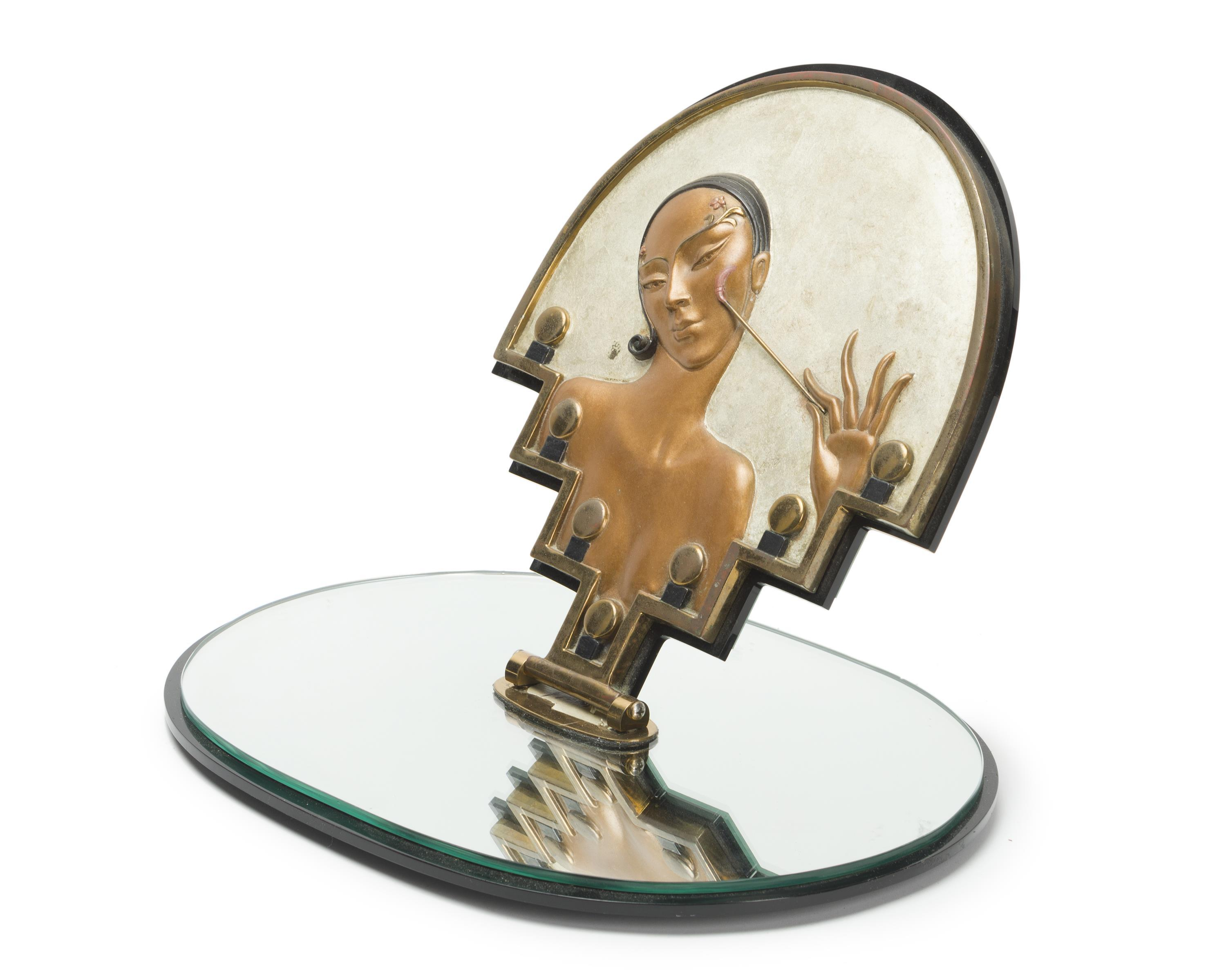 "Romain (Erté) de Tirtoff, (1892-1990 Russian), ""Vanity"" mirror, Patinated and cold-painted bronze on a mirrored swivel base, 13.5""H x 1"