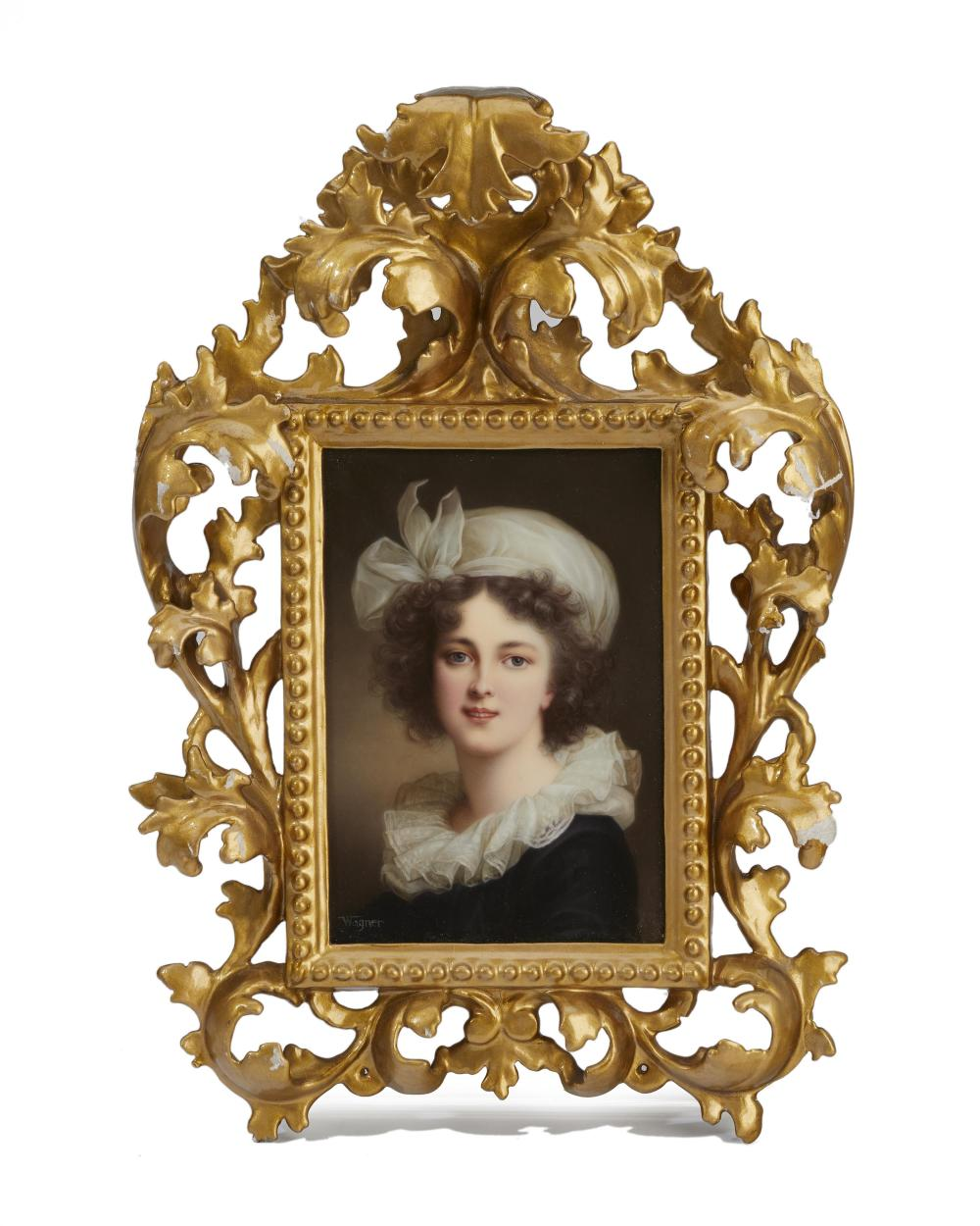 A Royal Vienna portrait plaque with carved frame