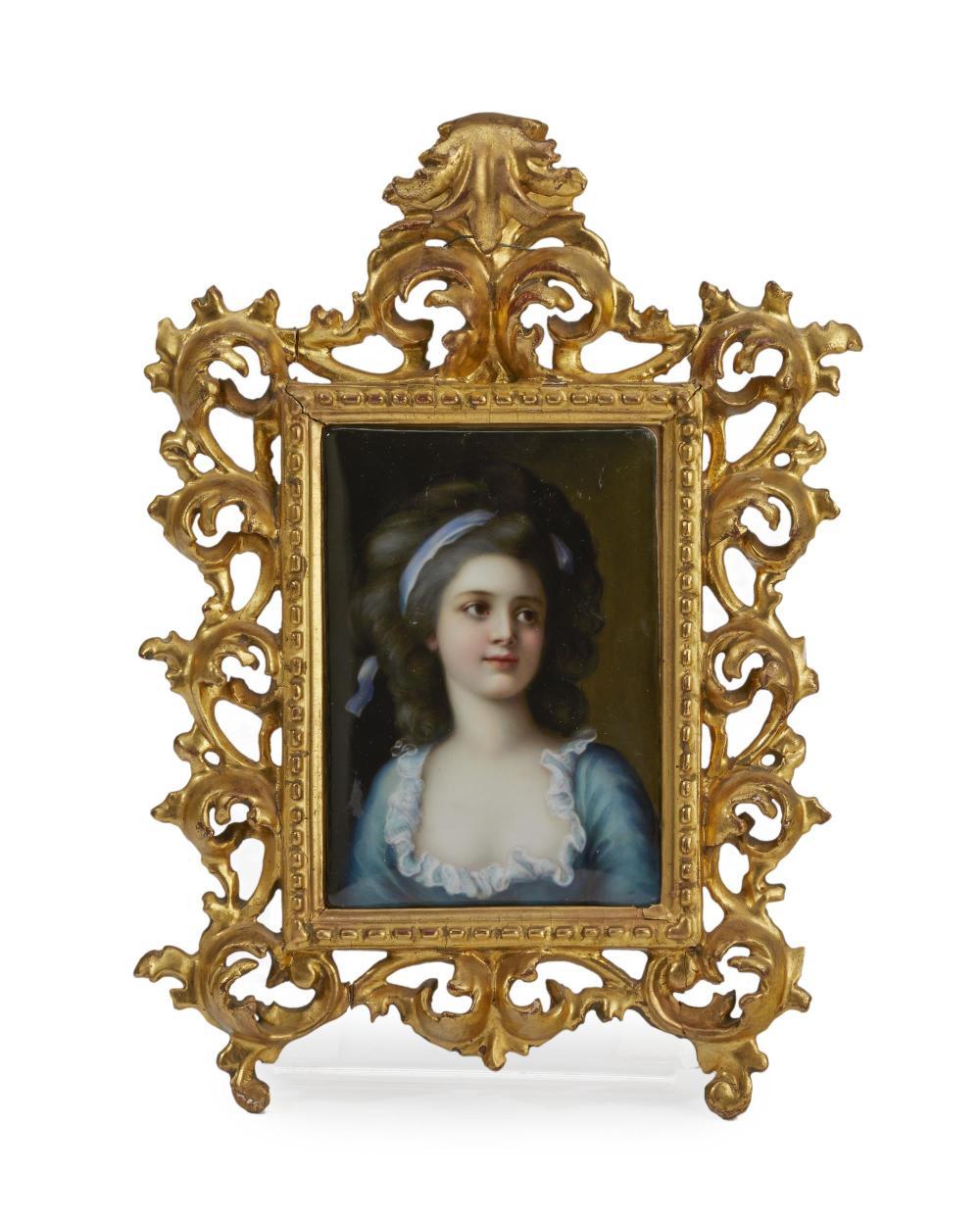 A framed painted porcelain portrait plaque