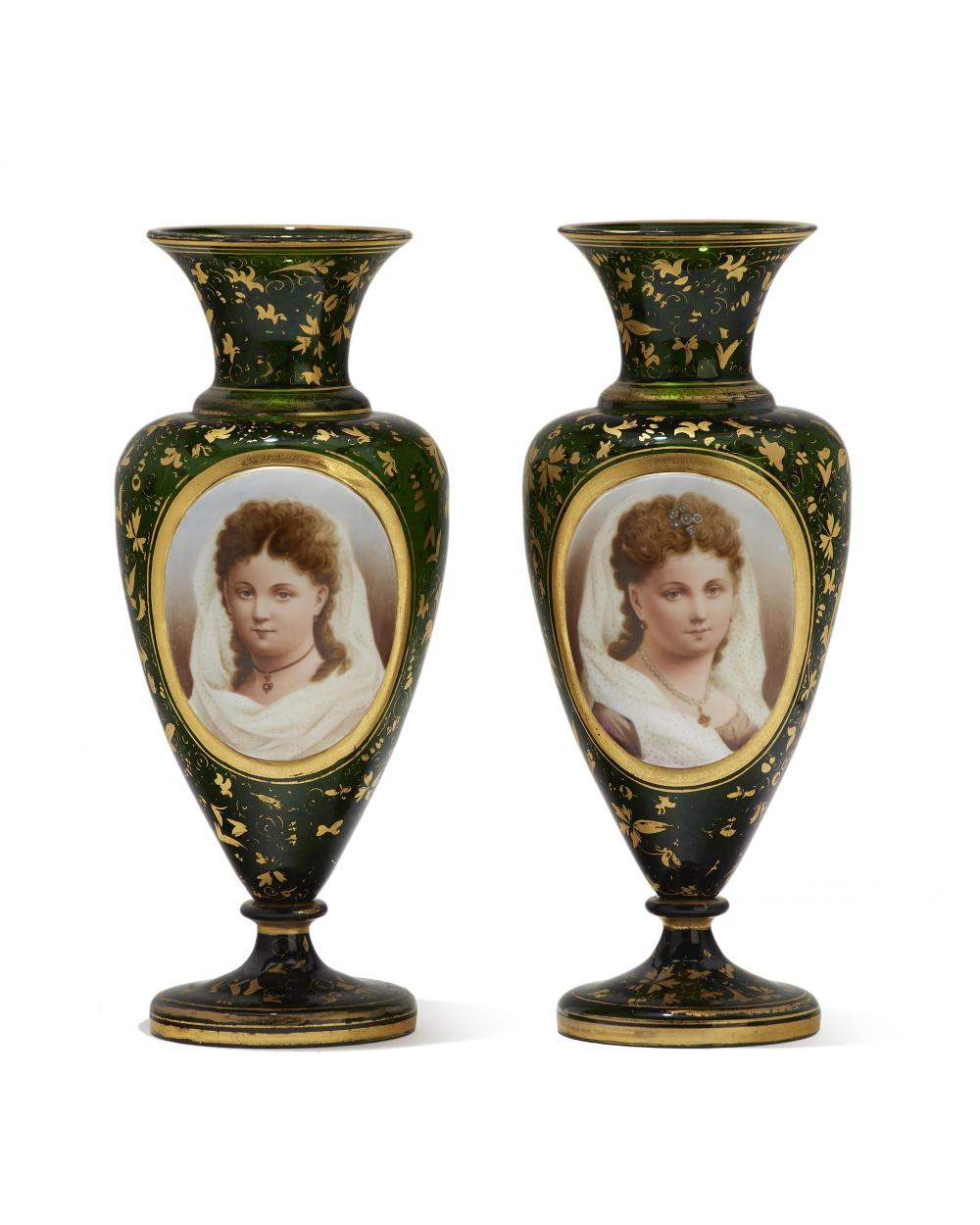 A pair of green Bohemian glass portrait vases