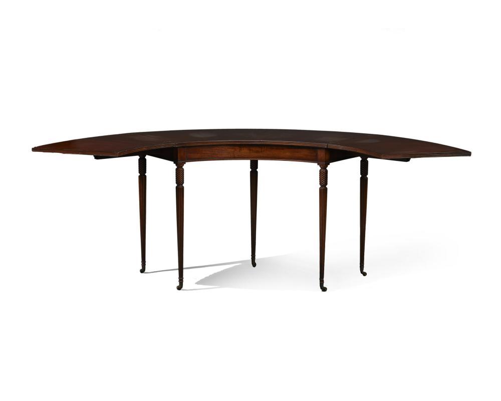 A mahogany half-circle hinged fold-out desk
