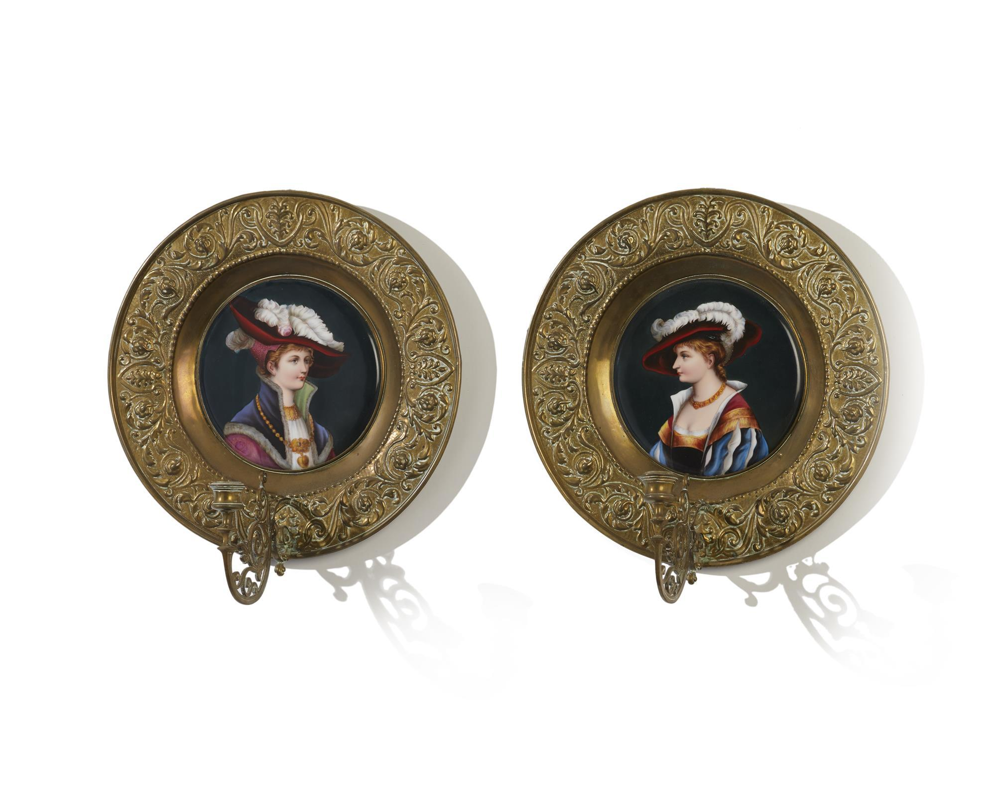 A pair of porcelain and brass wall sconces
