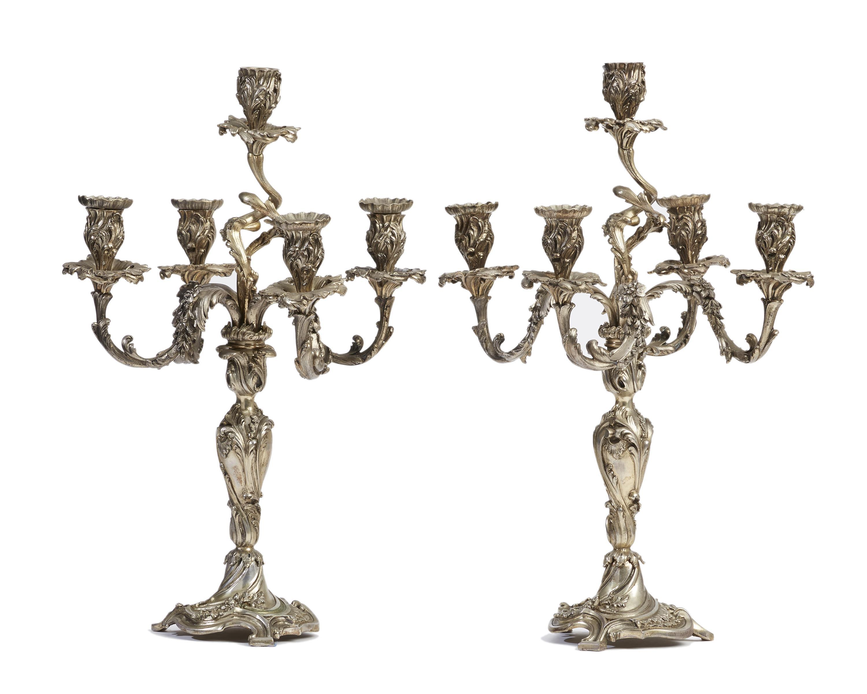 A pair of silvered bronze candelabra