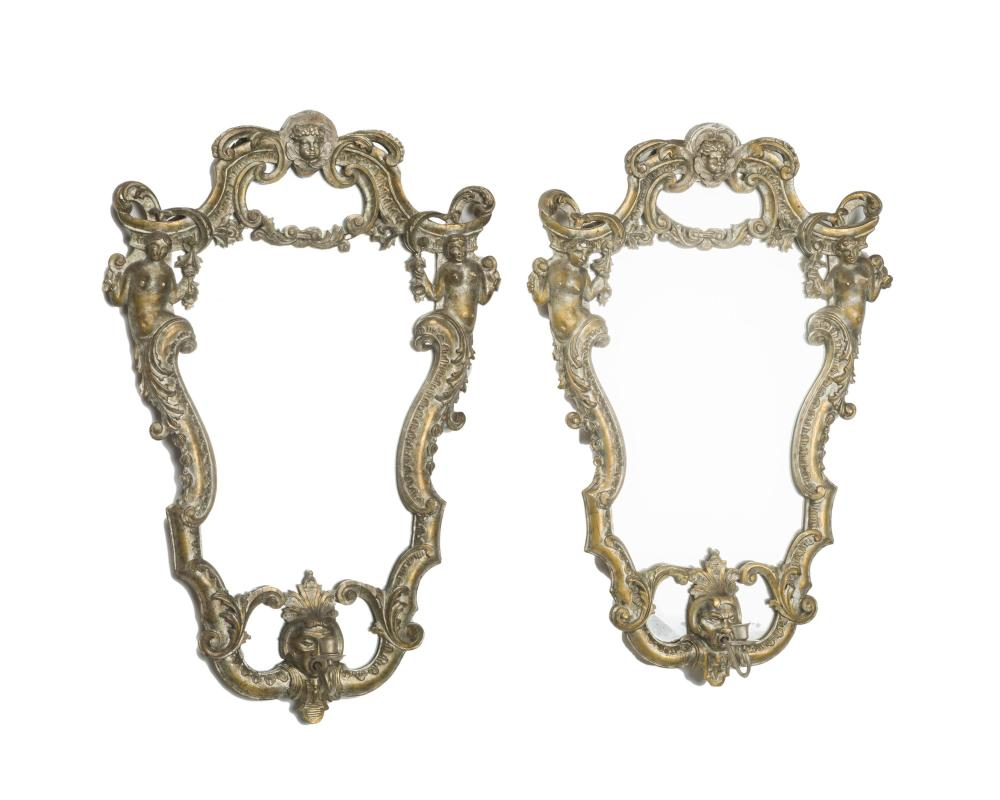 A pair of Italian silvered and giltwood mirrors