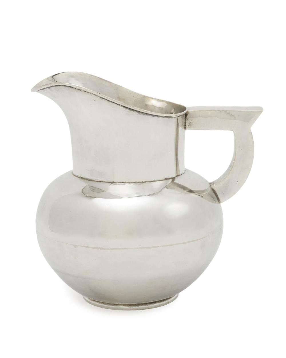 A Hector Aguilar sterling silver water pitcher