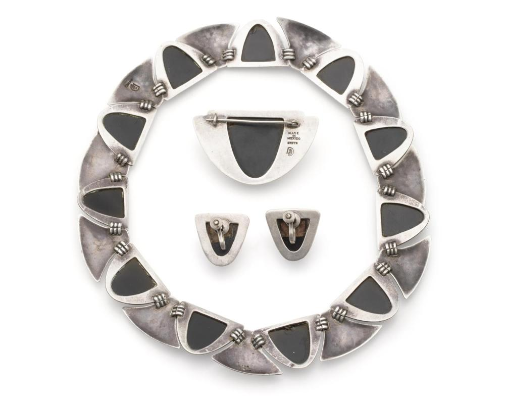 A suite of Fred Davis Mexican silver and obsidian mask jewelry