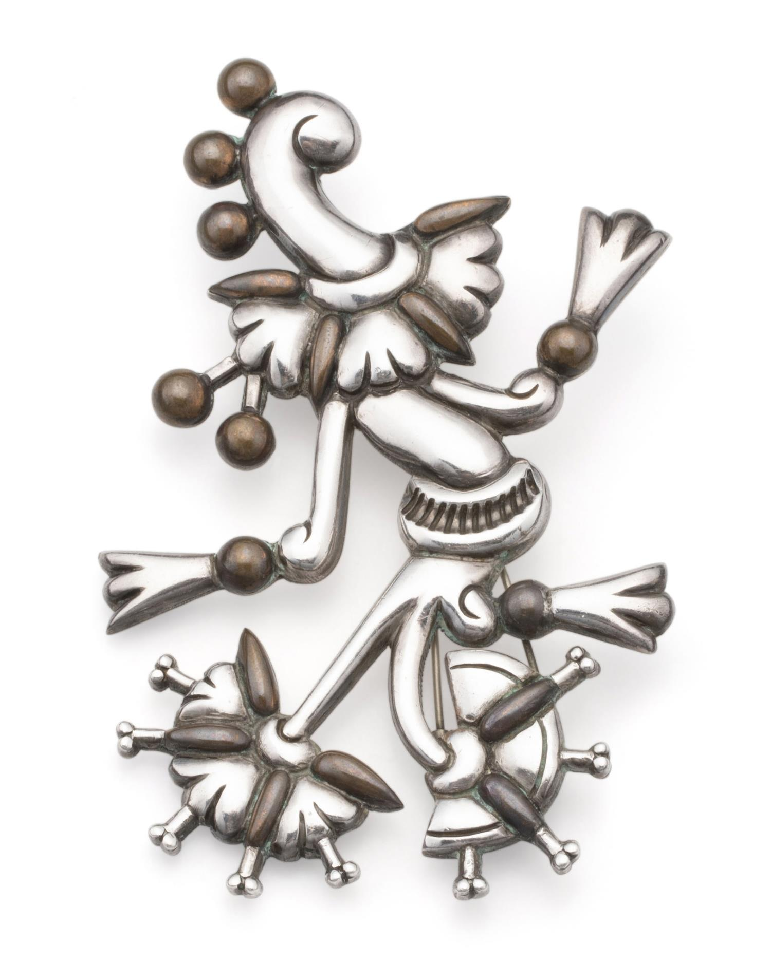 """A William Spratling """"Tree of Life"""" silver and copper brooch"""