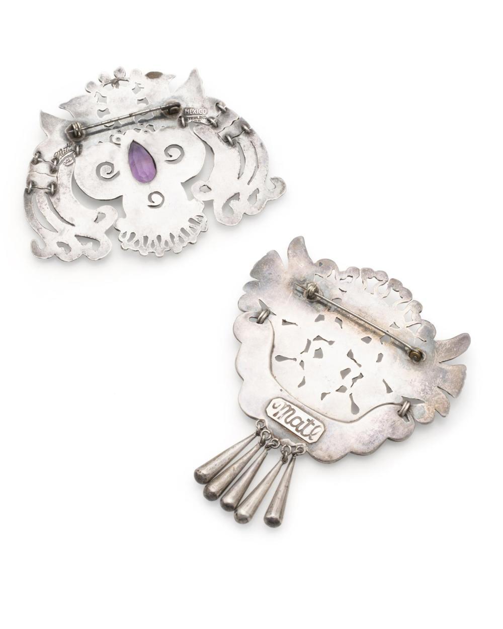 Two Matilde Poulat bird brooches