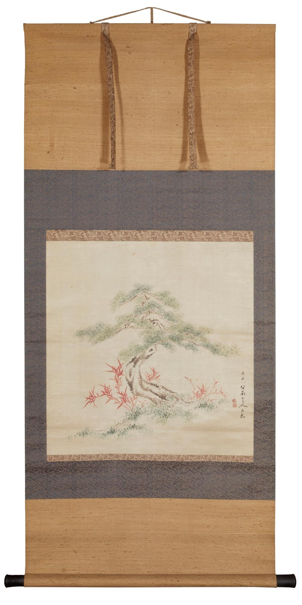 A Japanese scroll with a tree
