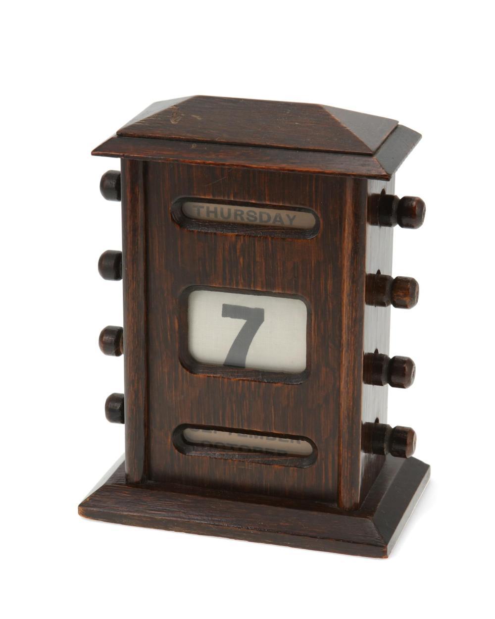 A wood perpetual desk calendar