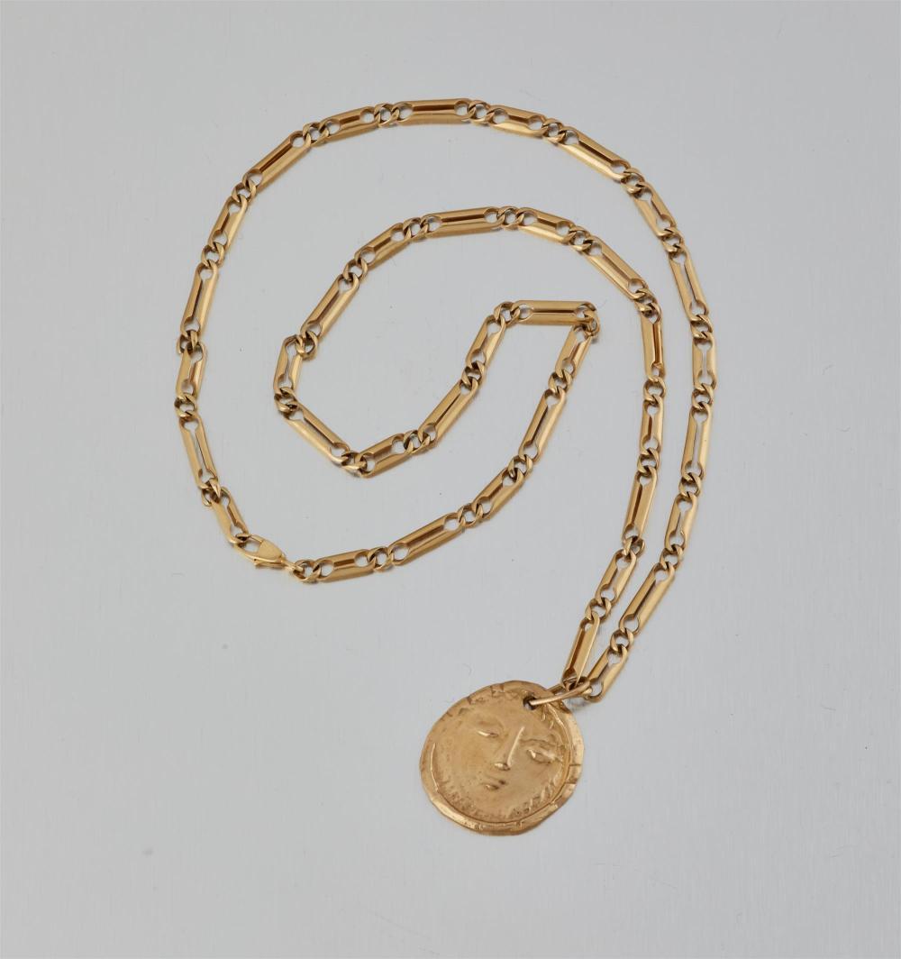 "Pablo Picasso, (1881-1973, Spanish), ""Visage"" sun-motif pendant, designed 1949, 18k yellow gold pendant on a 14k yellow gold chain, Pen"