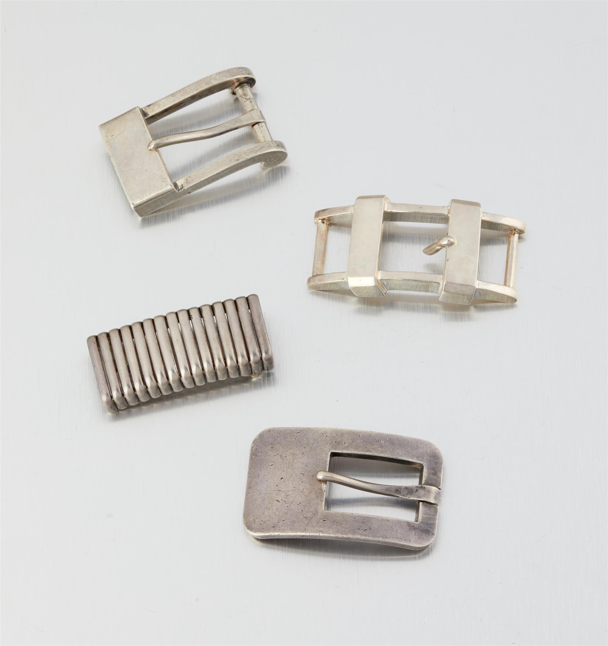 Four Antonio Pineda silver belt buckles