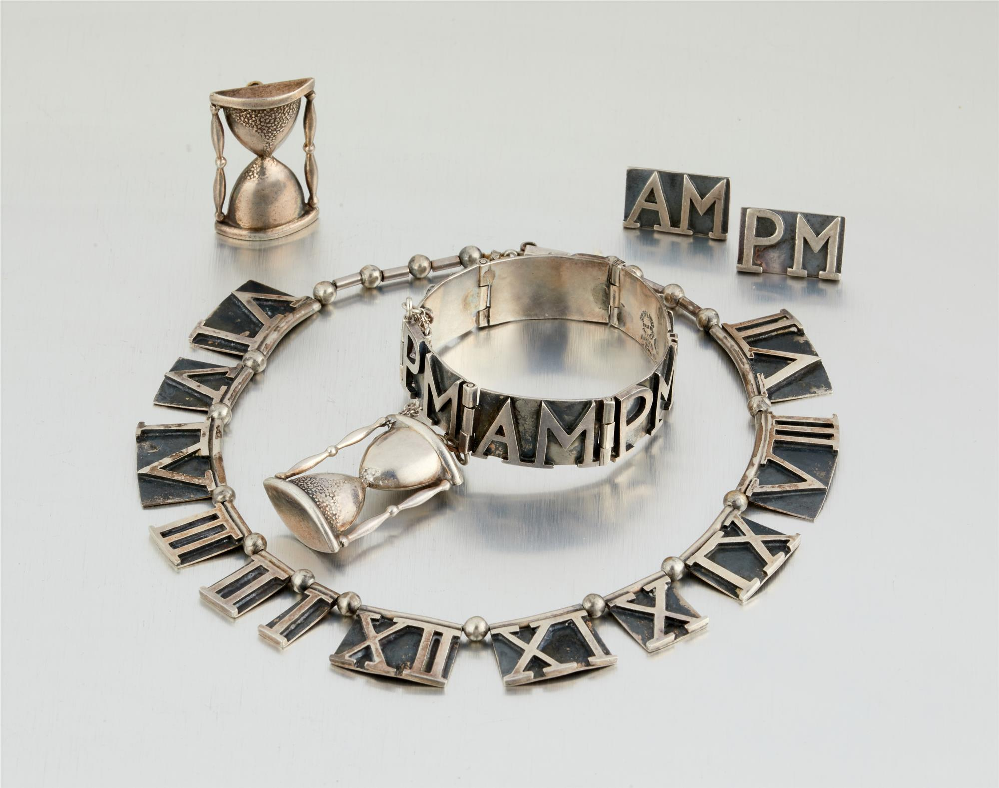 "A suite of Margot de Taxco ""AM-PM"" silver jewelry"