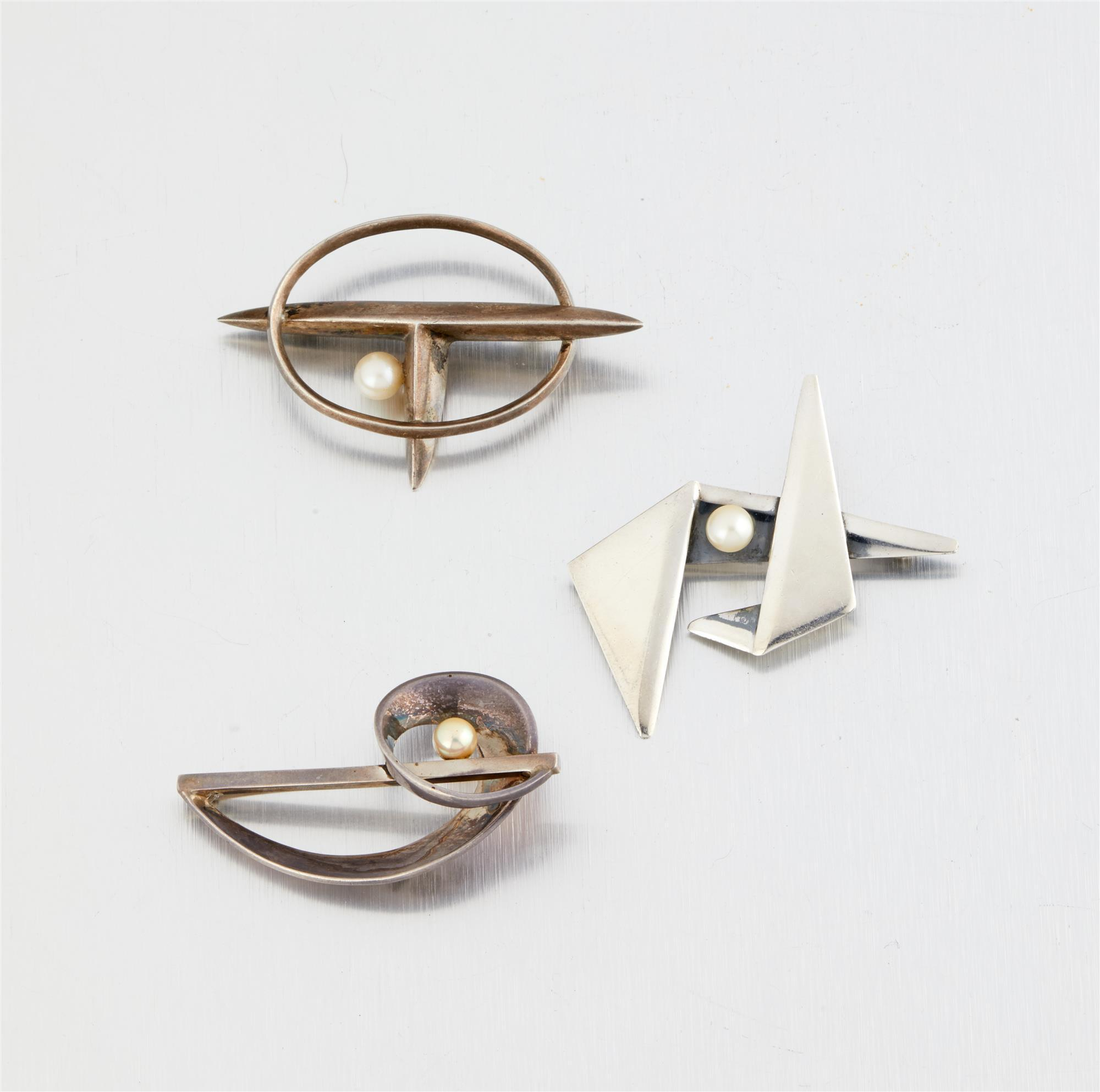 A group of Antonio Pineda silver and pearl brooches