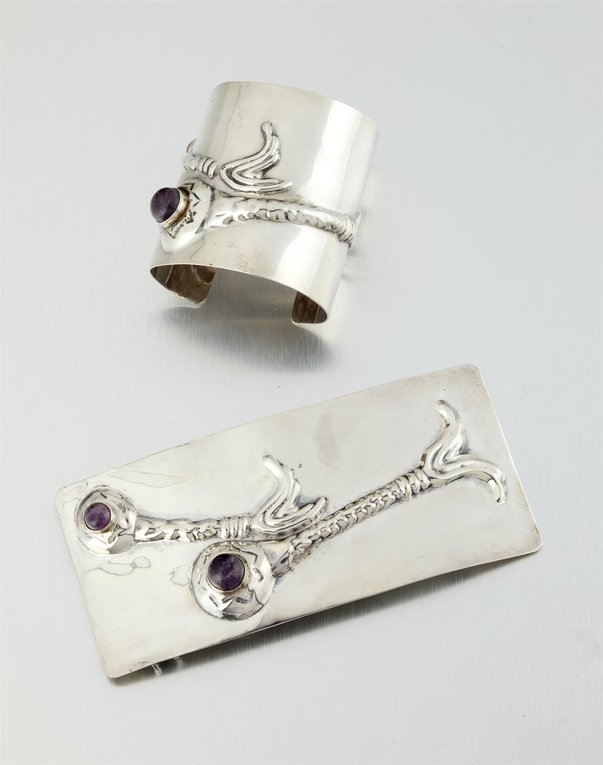 """Two Hubert Harmon sterling silver """"Cyclops"""" or """"Sea Serpent"""" items"""