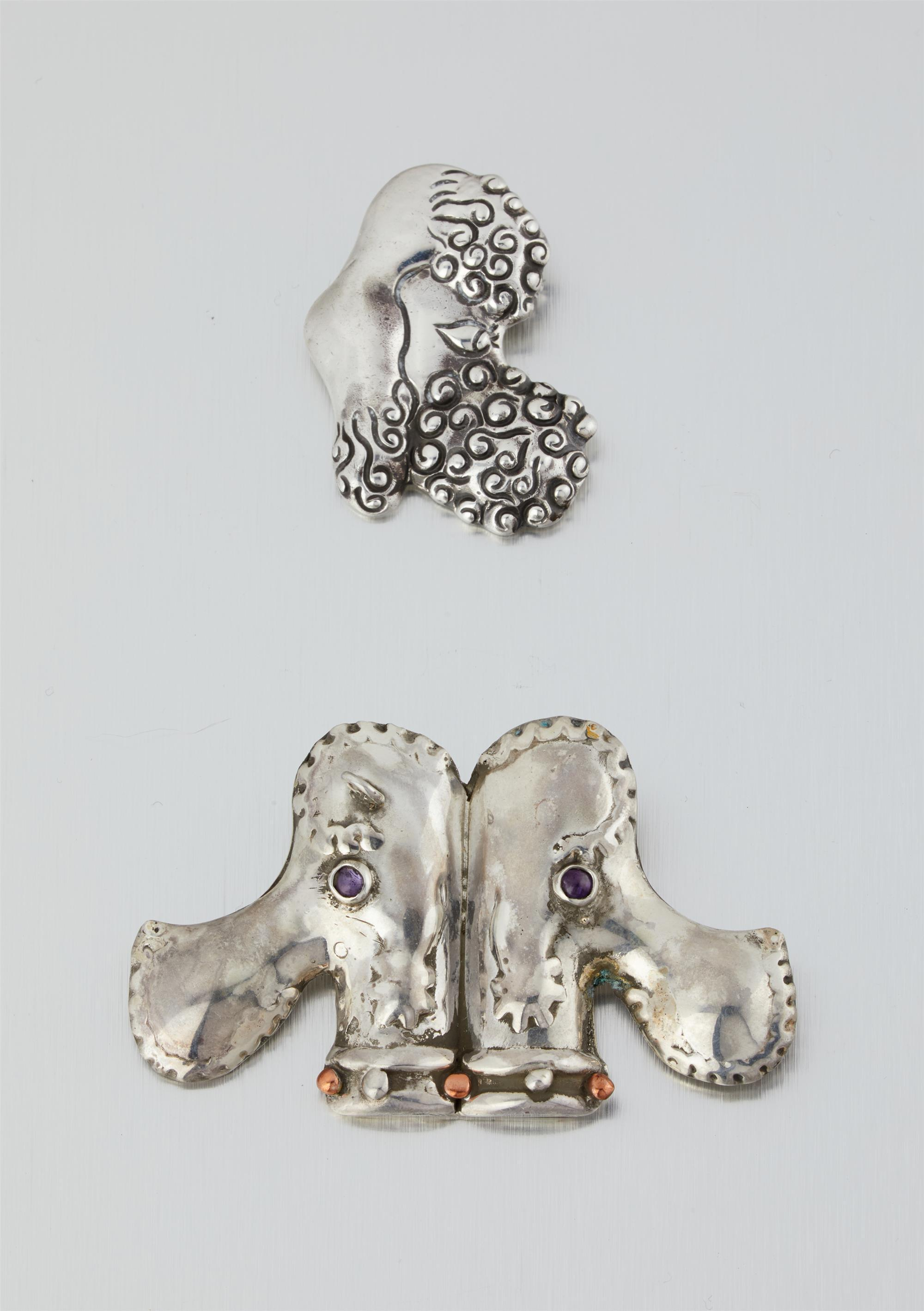 Two Hubert Harmon silver poodle brooches