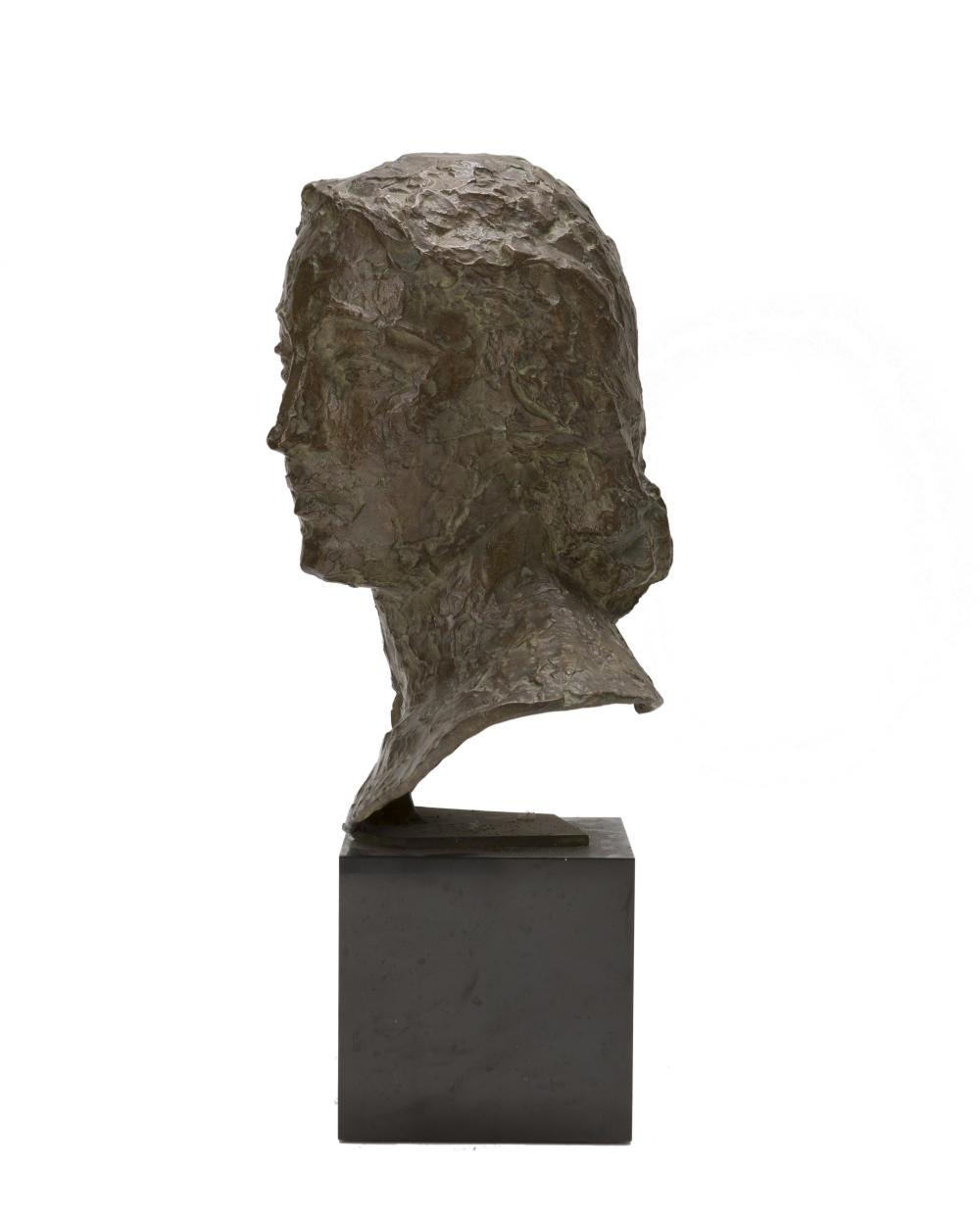 Robert Wlerick, (1882-1944 French), Bust of a woman, Patinated cast bronze on marble plinth, 12.625