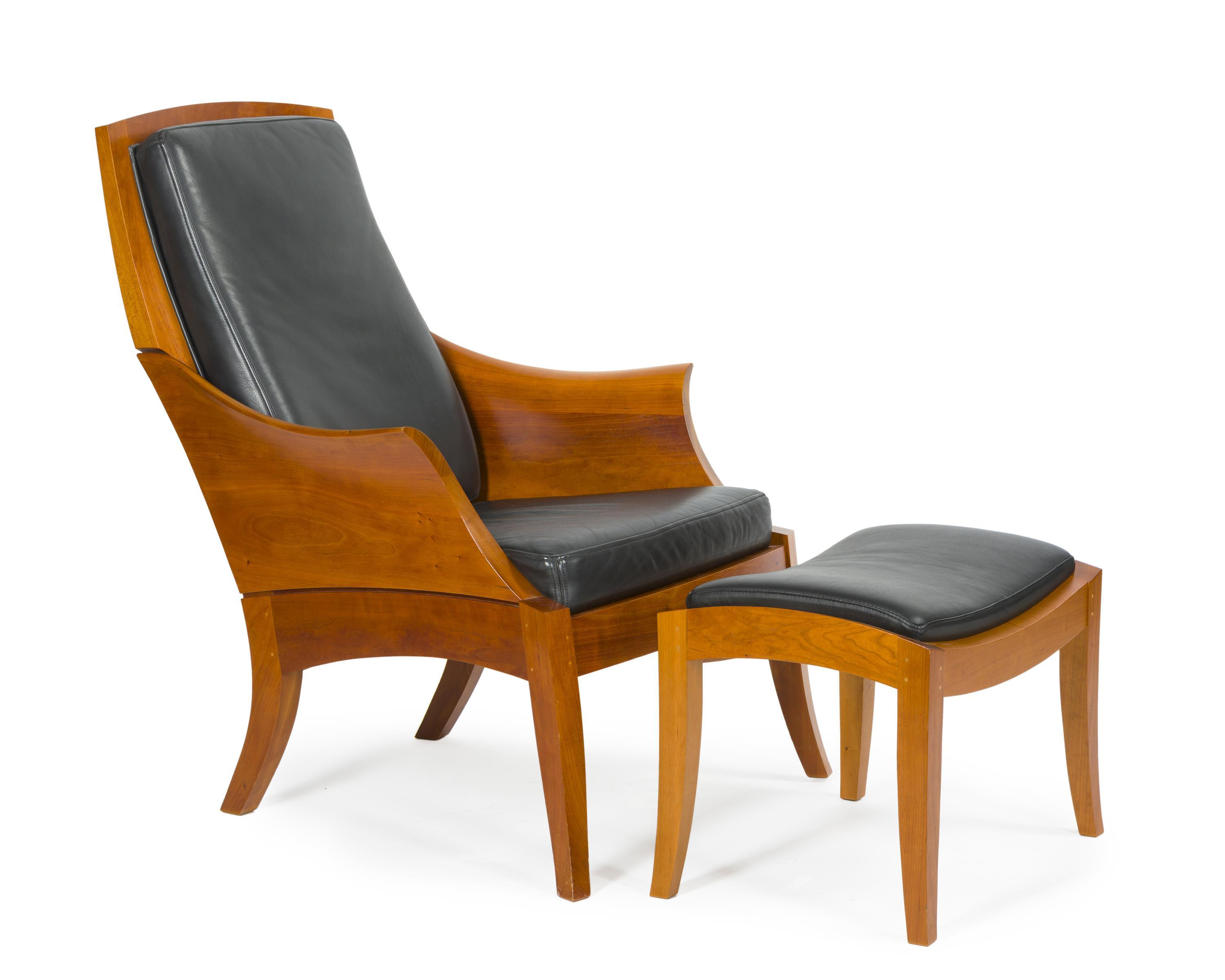 A Thomas Moser wing chair and ottoman