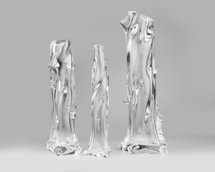 A set of three graduated Steuben art glass vases