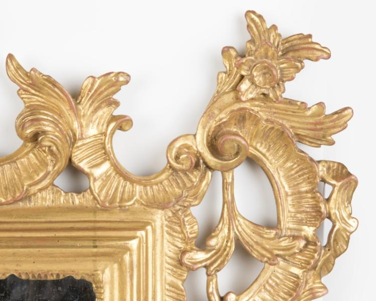 A Continental carved and giltwood wall mirror